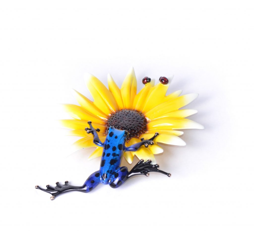 bronze frog and flower